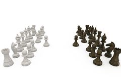 Wooden chess pieces facing off Royalty Free Stock Photography