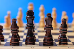 Wooden chess pieces ready to fight. Royalty Free Stock Photo