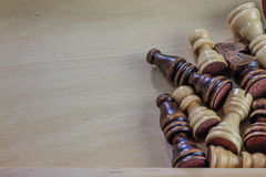 Wooden chess pieces wooden background. Stock Photo