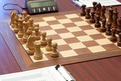 Wooden chess is placed on chessboard Royalty Free Stock Images