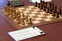 Wooden chess is placed on chessboard. Stock Photos