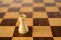 Wooden chess set, white rook on board Royalty Free Stock Photography