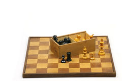 Wooden chessboard. Old and aged wooden chessboard with box and chess pieces Stock Photo
