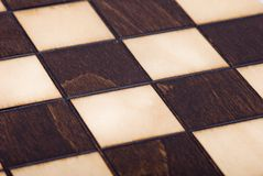 Wooden chessboard. Viewed from interesting angle Royalty Free Stock Images