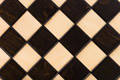 Wooden chessboard. Viewed from interesting angle Stock Photos