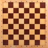 Wooden chessboard stock image