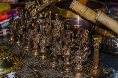 Wooden chessboard with figures in the form of ancient warriors o royalty free stock photo