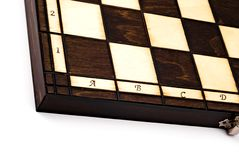 Wooden chessboard isolated on white. Wooden chessboard viewed from interesting angle Royalty Free Stock Photo