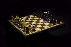Wooden chessboard with wooden pieces Stock Photography