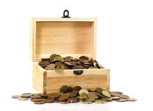 Wooden chest with coins. In a white background Royalty Free Stock Photography