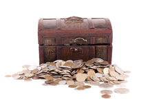 Wooden chest with coins Stock Photos