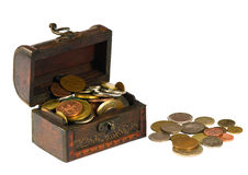 Wooden chest with coins Stock Photography