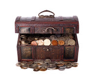 Wooden chest with coins inside Stock Photography