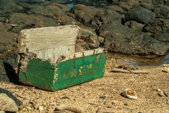 Wooden chest coughed up by the ocean's depths Royalty Free Stock Images