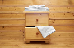 Wooden chest of drawers with bath towel Stock Photography