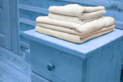 Wooden chest of drawers with bath towel Royalty Free Stock Photos