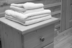Wooden chest of drawers with bath towel Stock Image