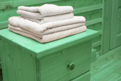 Wooden chest of drawers with bath towel Royalty Free Stock Images
