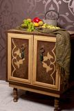 Wooden chest of drawers in east style with fruits Royalty Free Stock Image