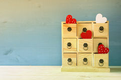 Wooden chest with drawers and hearts. On the table Stock Images