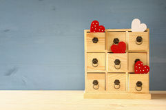 Wooden chest with drawers and hearts. On the table Stock Photo