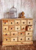 Wooden chest of drawers in shabby styled room with bird cage and Royalty Free Stock Photography