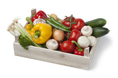 Wooden chest with fresh vegetables Stock Image