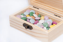 Wooden chest gift box with colorful round chocolates Royalty Free Stock Photography