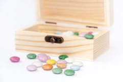 Wooden chest gift box with colorful round chocolates Royalty Free Stock Images
