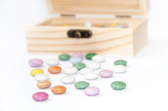 Wooden chest gift box with colorful round chocolates Royalty Free Stock Photos