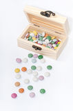 Wooden chest gift box with colorful round chocolates Stock Photo