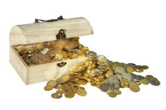 Wooden chest with golden coins Stock Image