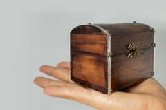Wooden chest on hand stock image