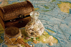 Wooden chest with jug and sea shells. Marine still life with sea shells and chests Royalty Free Stock Images