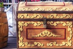 Wooden chest with lock and decorative ornament royalty free stock photo