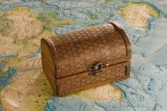 Wooden chest on the map. Closed wooden chest on the map Stock Images
