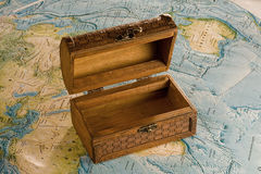 Wooden chest on the map stock image