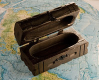 Wooden chest on the map Stock Photos