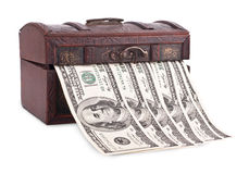 Wooden chest with money Stock Images