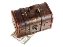 Wooden chest with money Stock Photo
