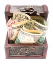Wooden chest with money on the white Royalty Free Stock Photography