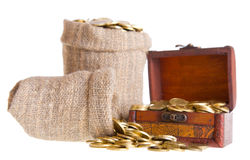 Wooden chest and two bags filled with coins Stock Photography