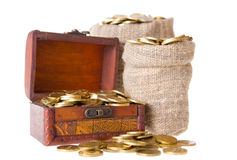 Wooden chest and two bags filled with coins Royalty Free Stock Images