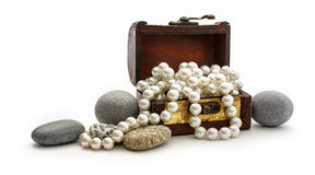 Wooden chest with white pearl necklace Stock Photo
