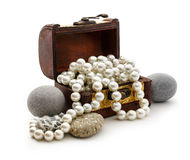 Wooden chest with white pearl necklace Stock Photos