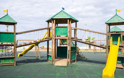 Wooden children game structure in playground area Royalty Free Stock Photography