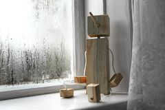 Wooden children's toy on a white window sill Stock Images