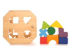 Wooden childs shape sorter toy. Cutout royalty free stock image