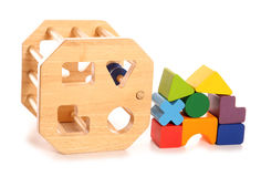 Wooden childs shape sorter toy. Cutout stock image