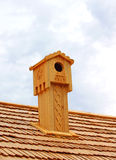 Wooden chimney. As nestling box Stock Photography